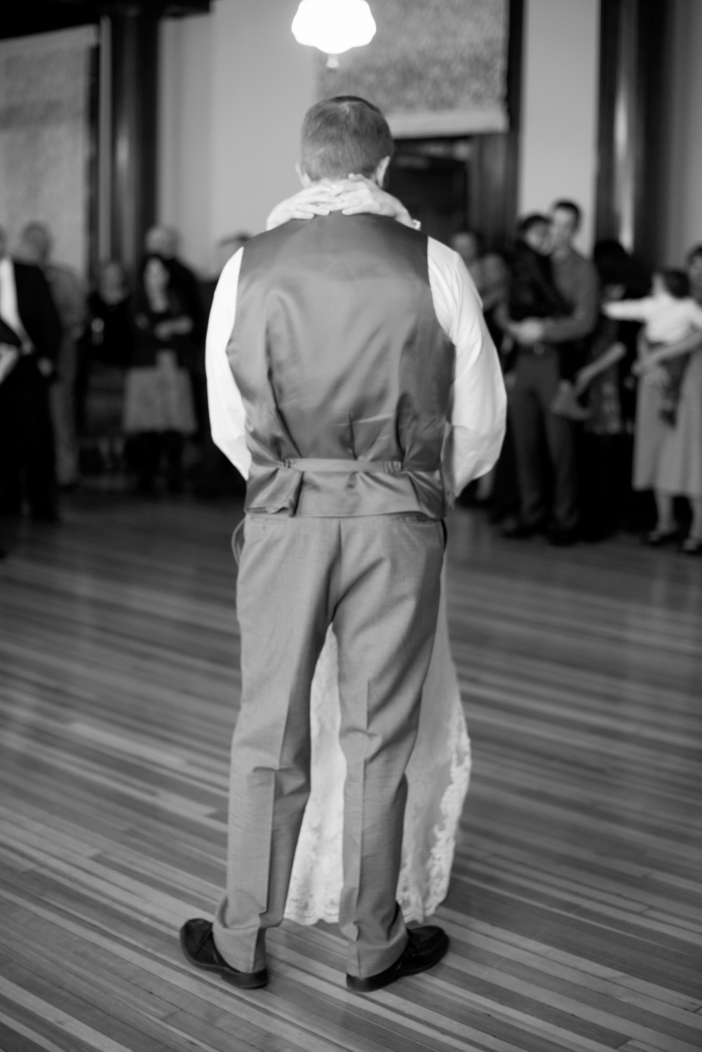 Bride and groom from behind during their first dance