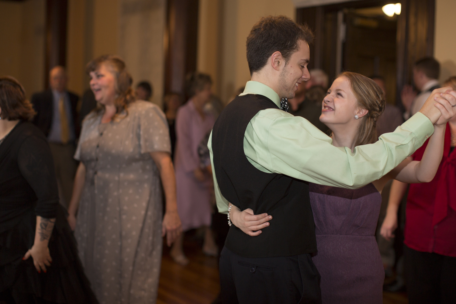 Wedding guests dance at reception