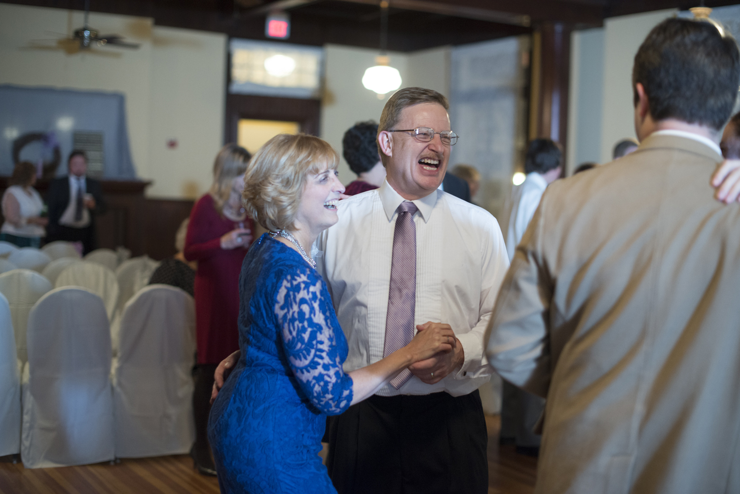 Mother and father of the bride dance at wedding reception