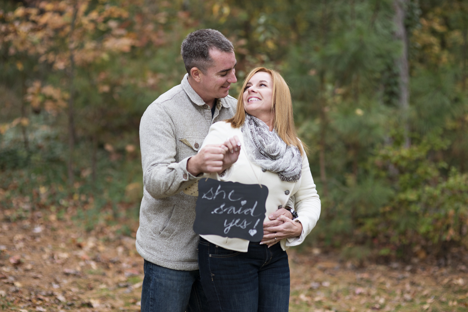 Cute fall engagement with she said yes chalkboard sign