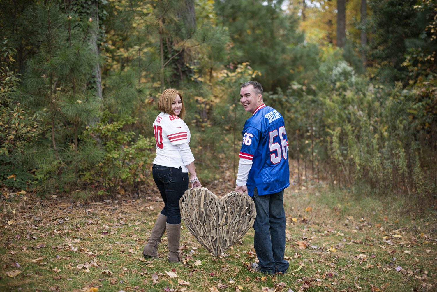Fall engagement session with New York Giants football jerseys