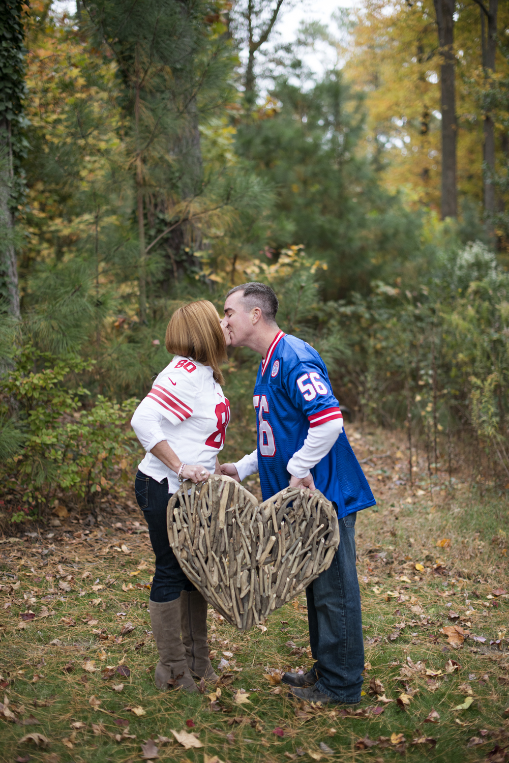 Fall engagement session with NFL jerseys