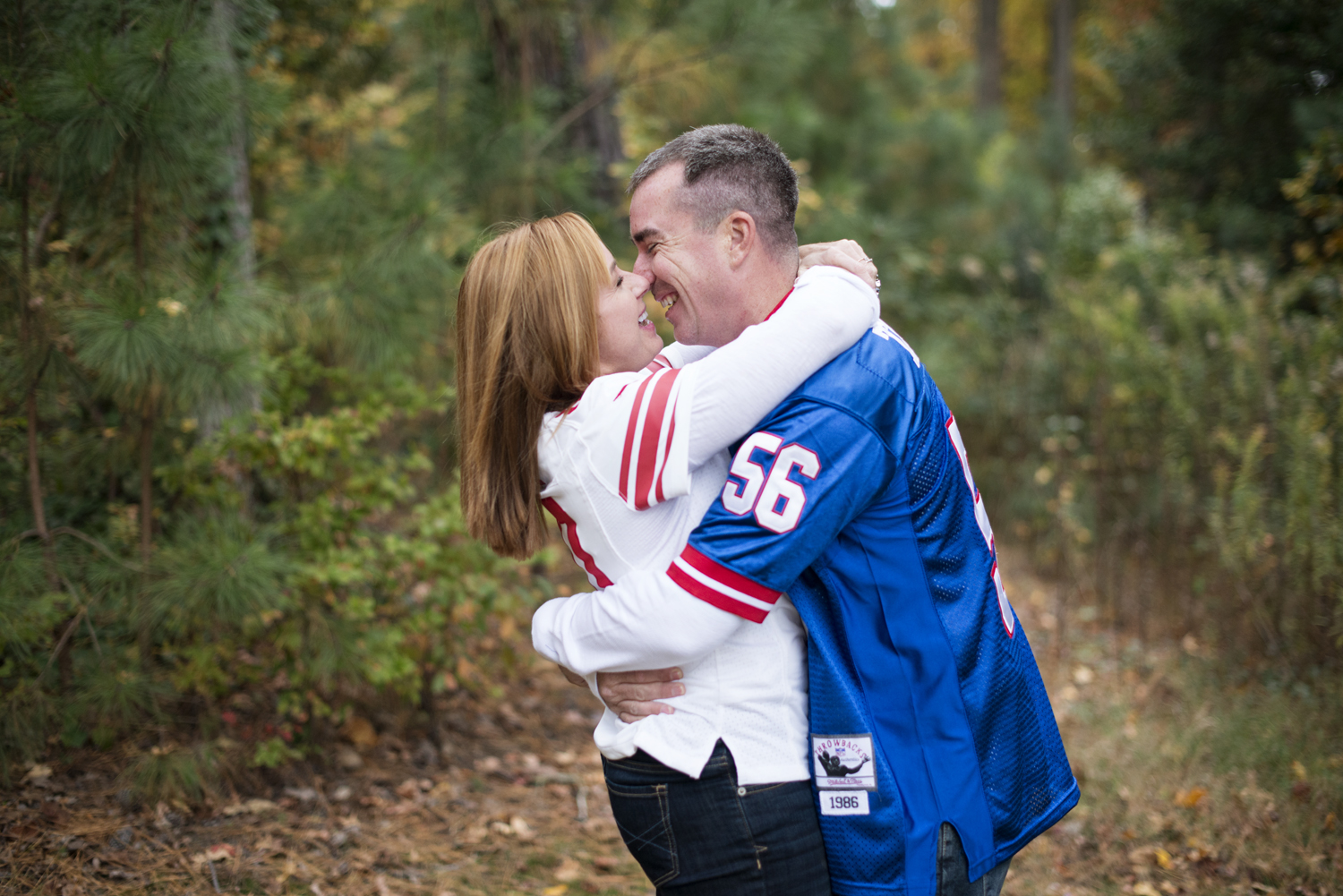 Fall engagement session with football jerseys