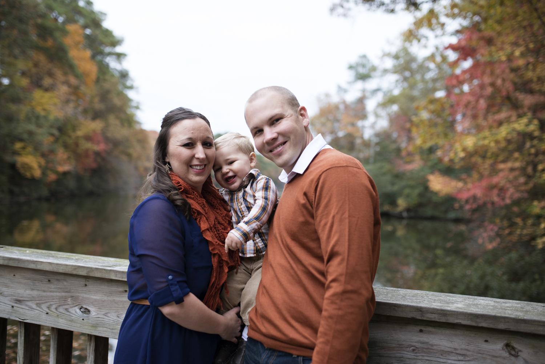 Autumn fun family pictures on a bridge