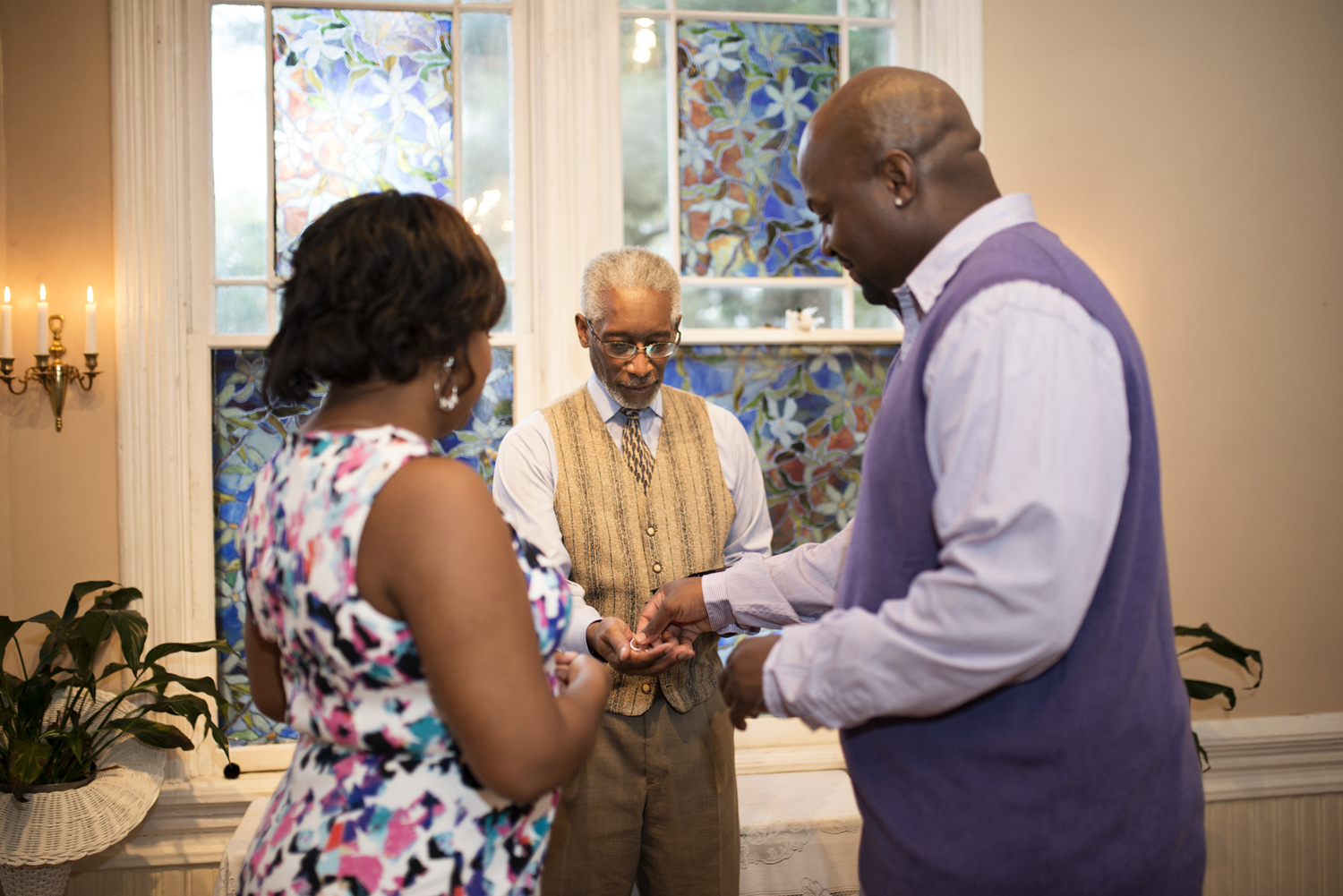 The groom reaches for the ring during a small Virginia elopement