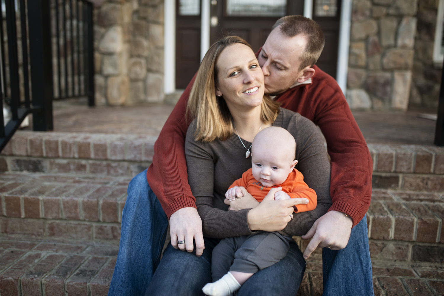 Fall family picture ideas for family of three on front steps of a house