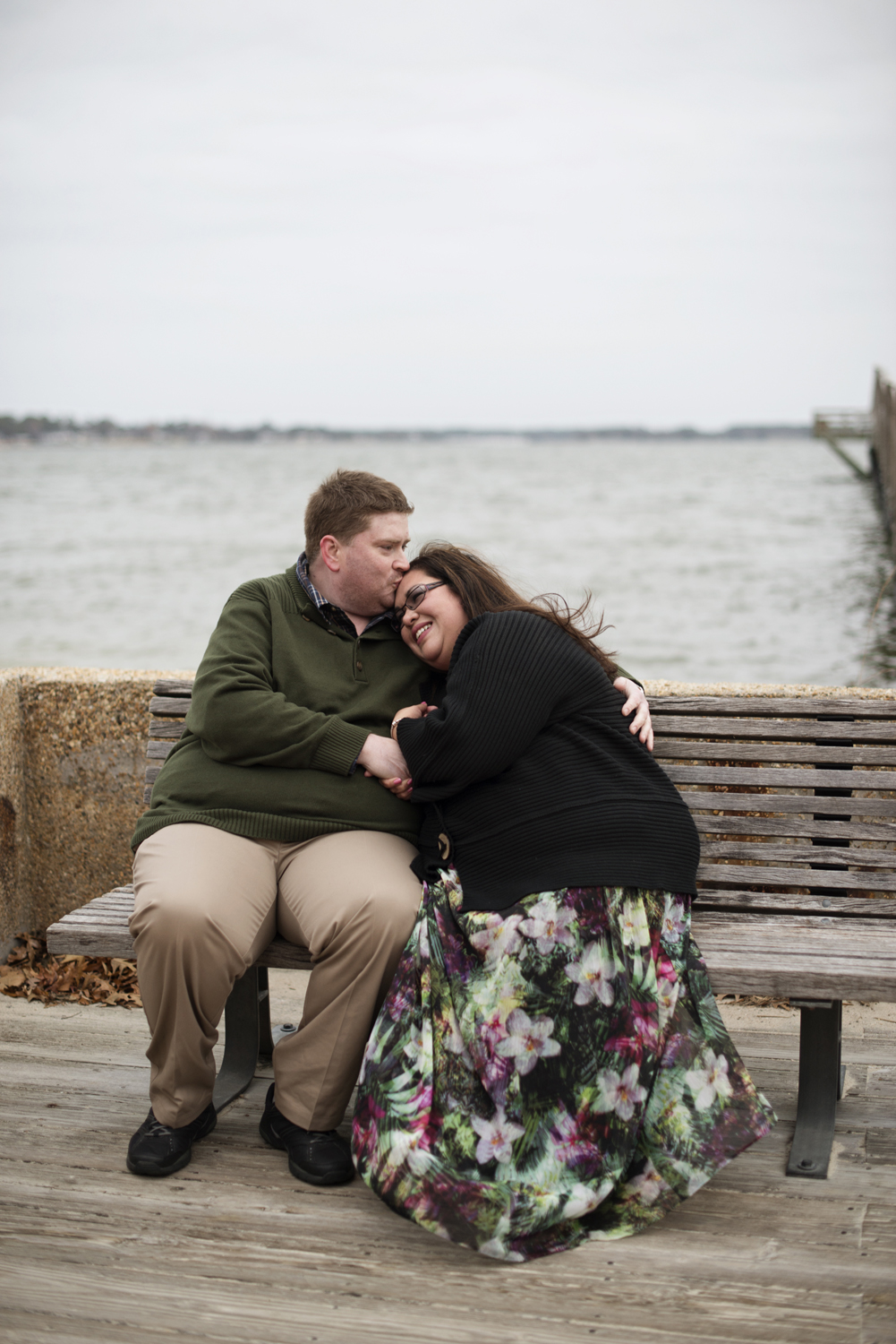 Posing ideas on a bench for an engagement session