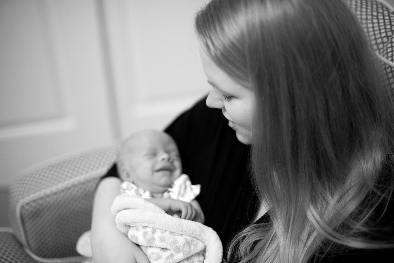 New mom with her newborn baby (black and white)