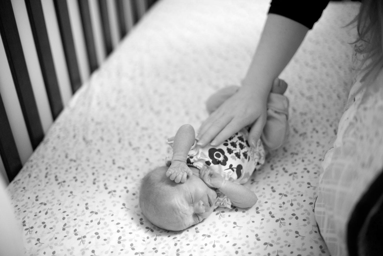 Newborn baby girl in her crib