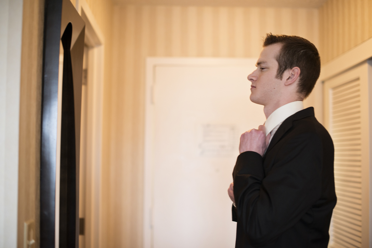 Groomsmen getting ready at a hotel in Virginia
