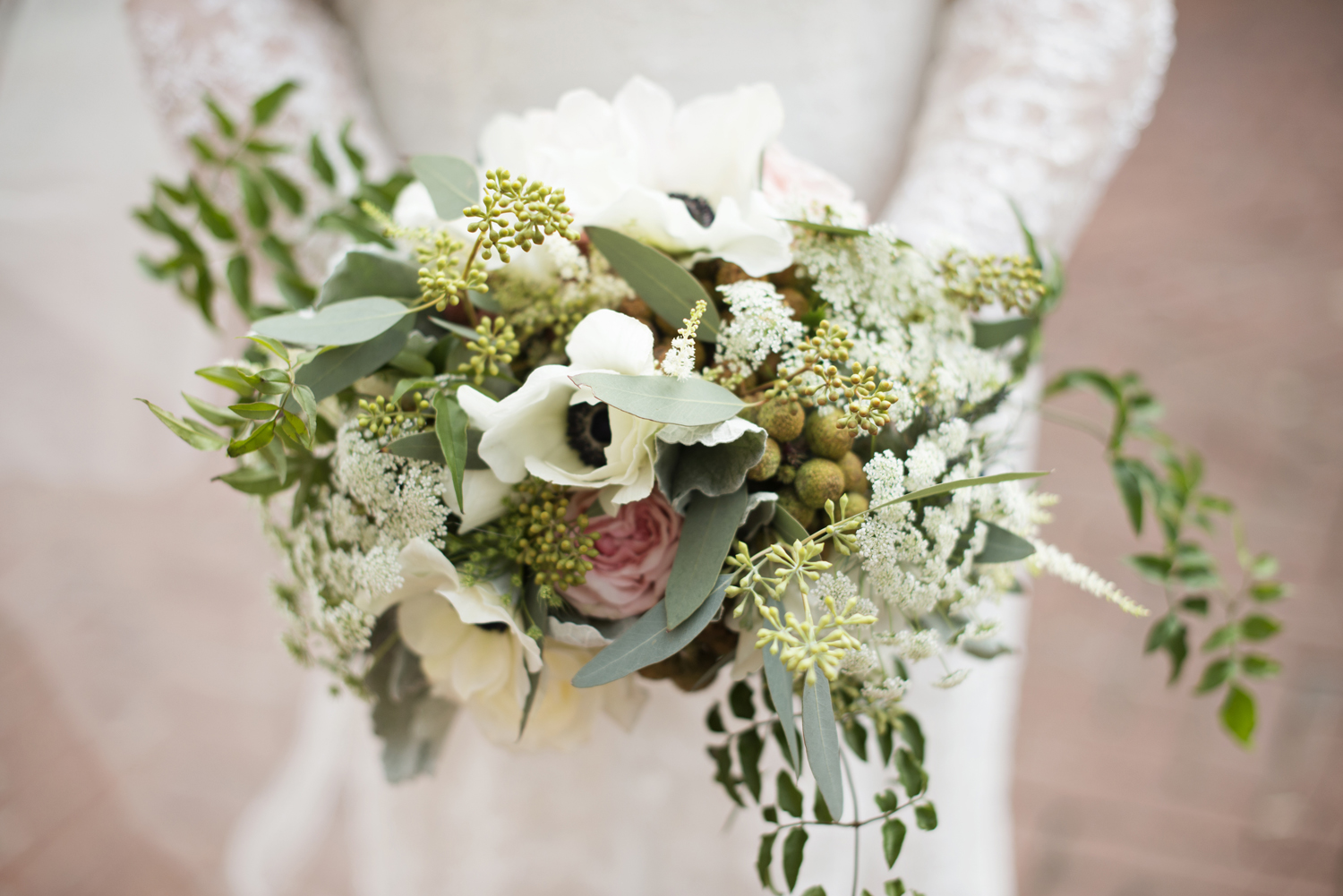 White and green bridal bouquet with pink carnations