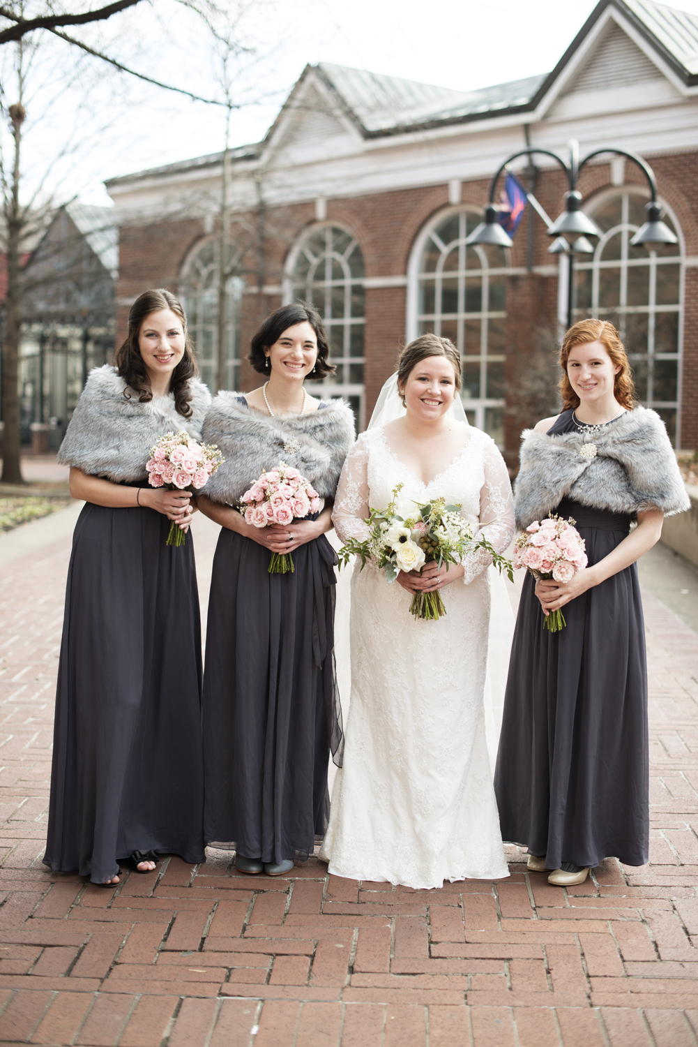 Lavender purple dresses with gray fur stoles for a December wedding