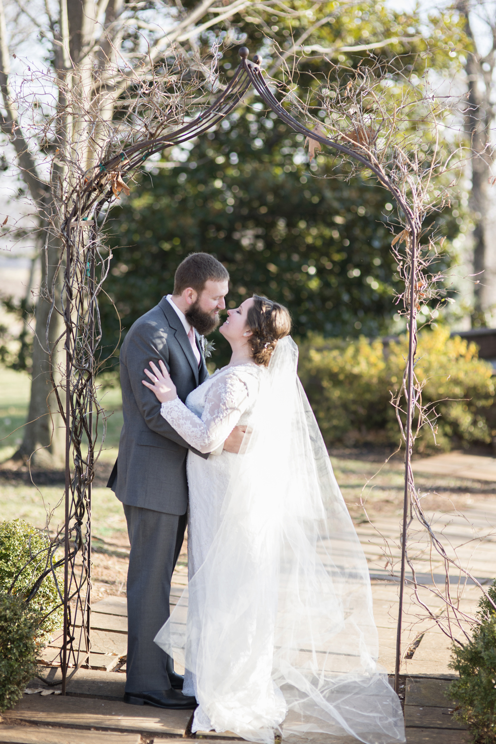 Bride and groom portraits under an arch