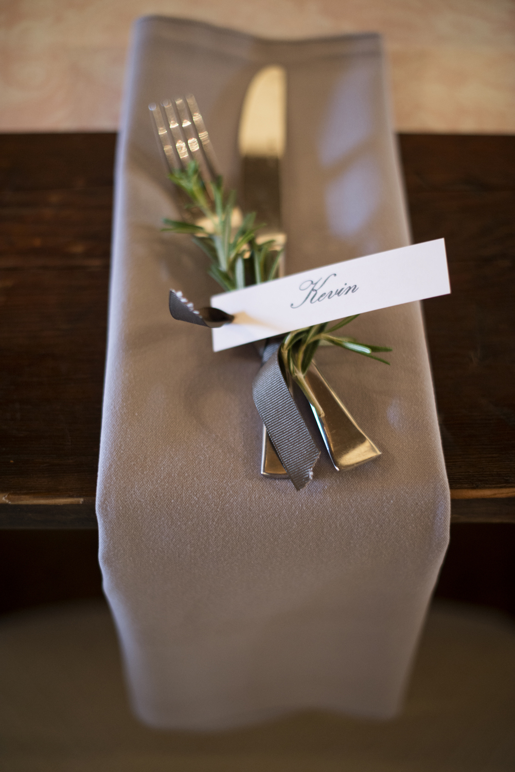Gray wedding theme with sprigs of rosemary for nametags