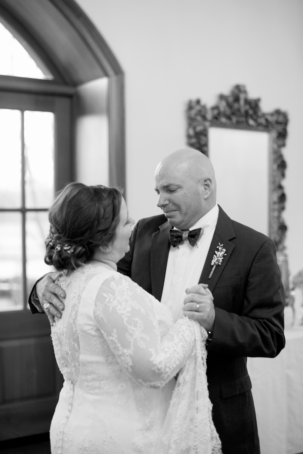 Bride's father cries during the first dance at her wedding