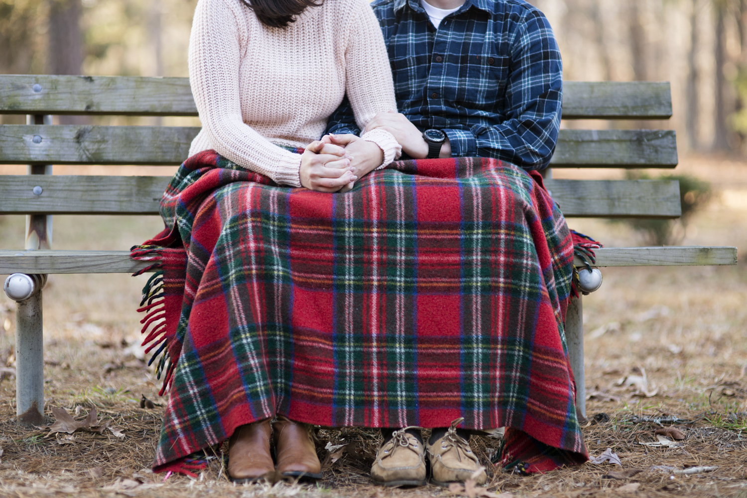 Plaid blanket, boots, and Sperry's engagement picture