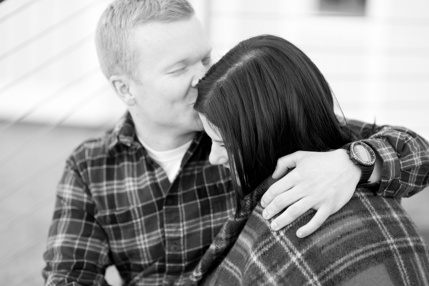 Intimate, romantic poses with a plaid blanket for engagement pictures