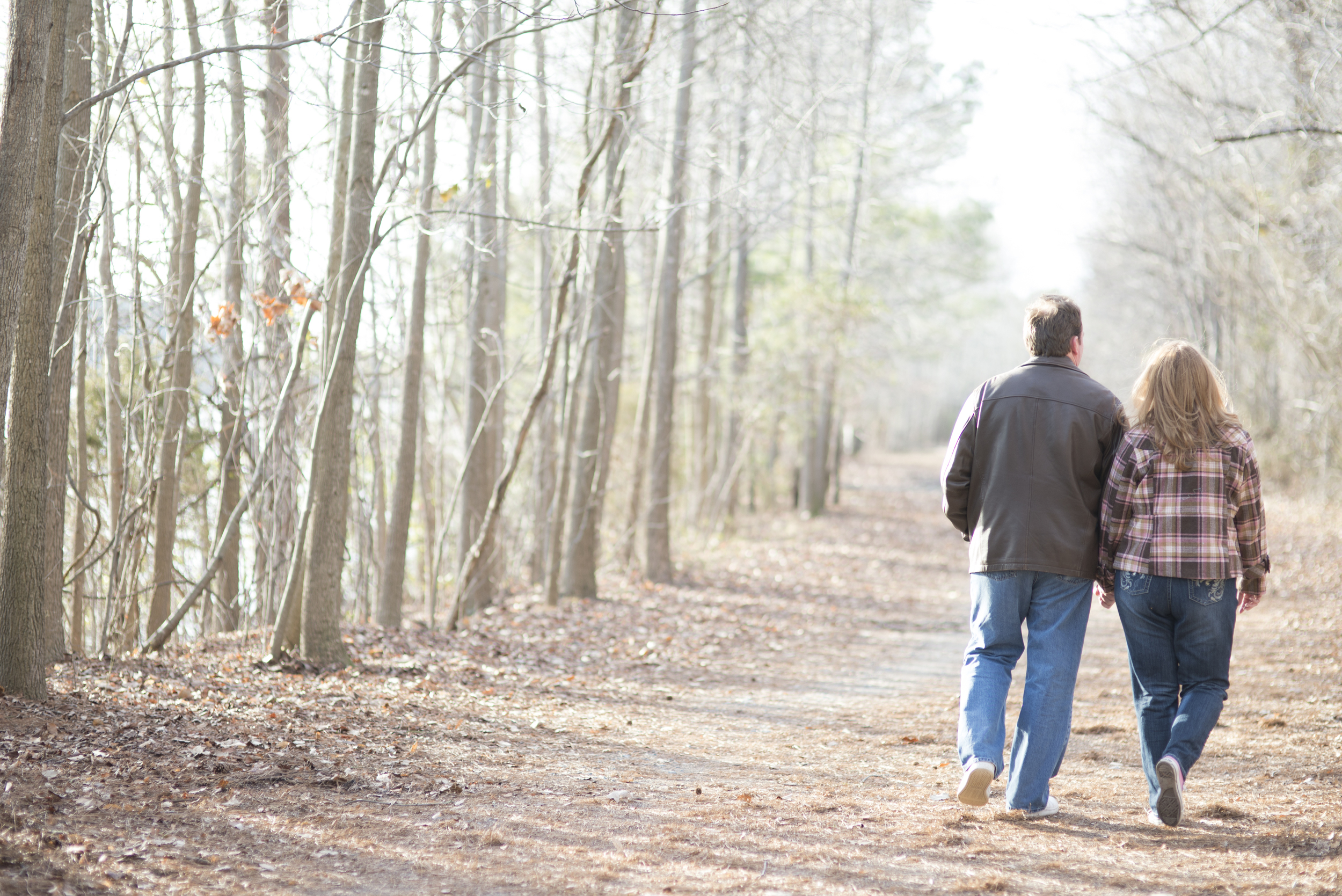 Engagement session on a walking path in the winter