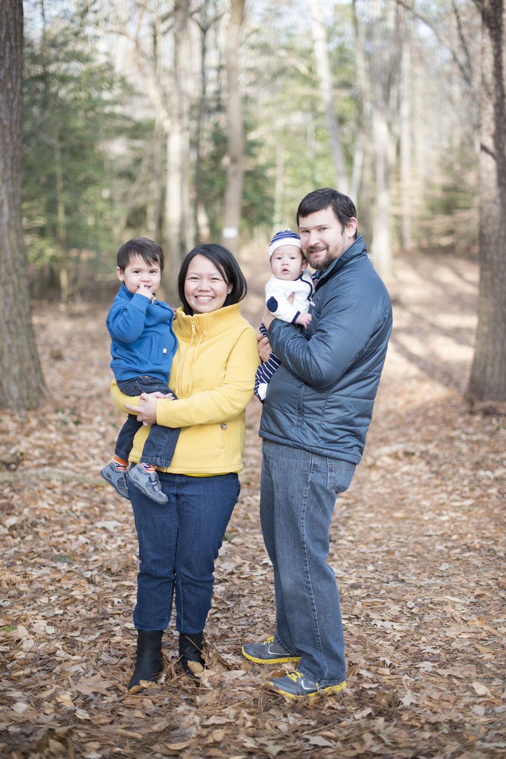 Winter family session with gray, blue, and mustard yellow
