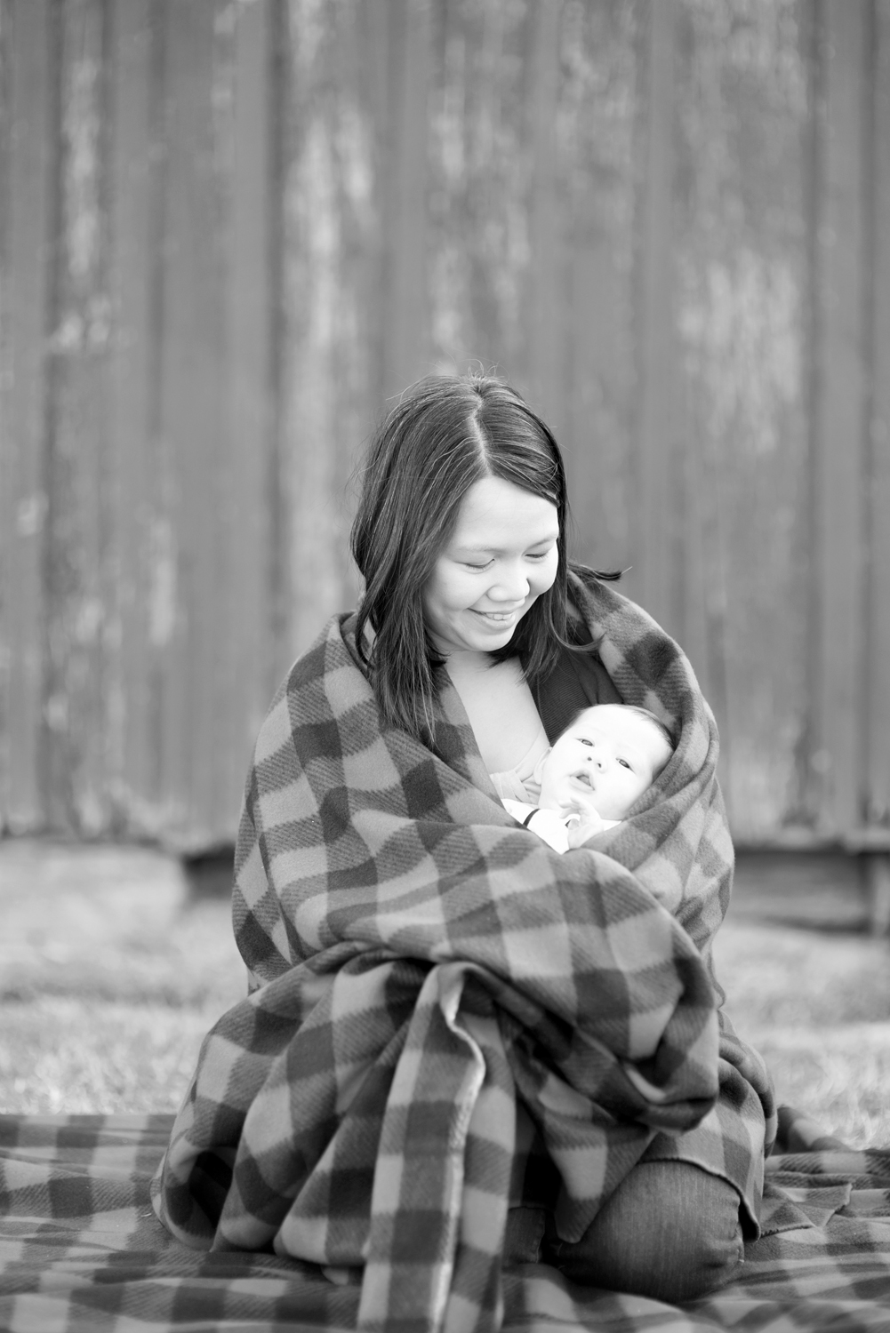 Family portrait session with mother and newborn baby (black and white)