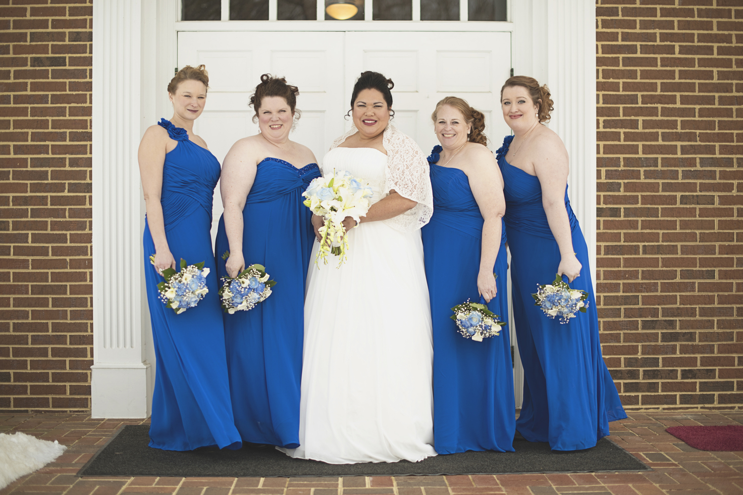 Blue one-shouldered bridesmaid dresses | Bridal party pictures