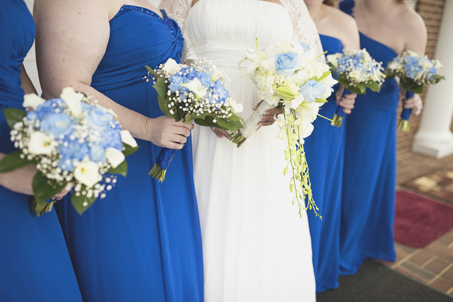 White calla lilies | Blue carnations | Baby's breath | Wedding bouquets