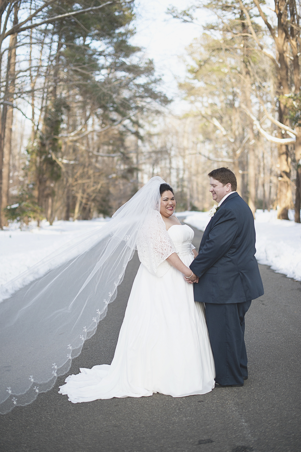 Bride & groom portraits in the snow | Cathedral veil | Winter wedding