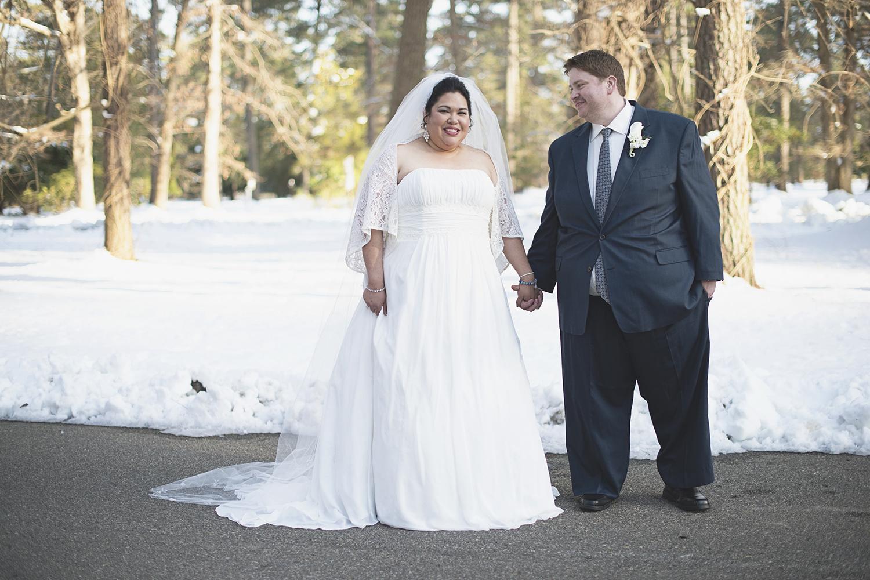 Snowy bride & groom portraits | Winter wedding | Cathedral veil