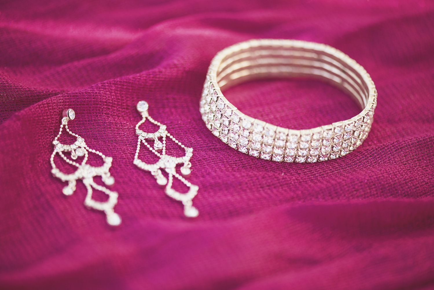 Pink and silver wedding details and jewelry