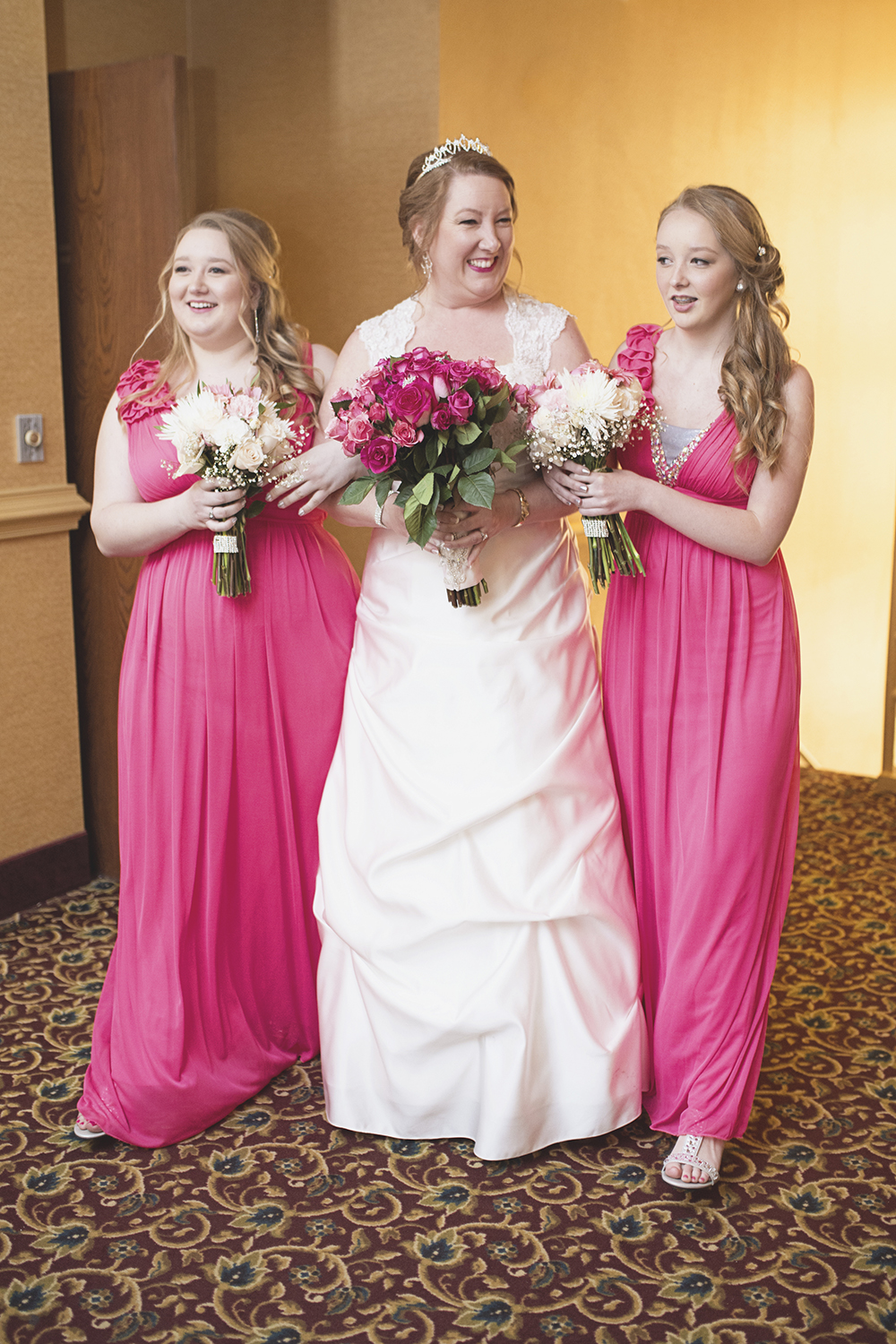 Bride walking down the aisle with her daughters | Pink wedding colors