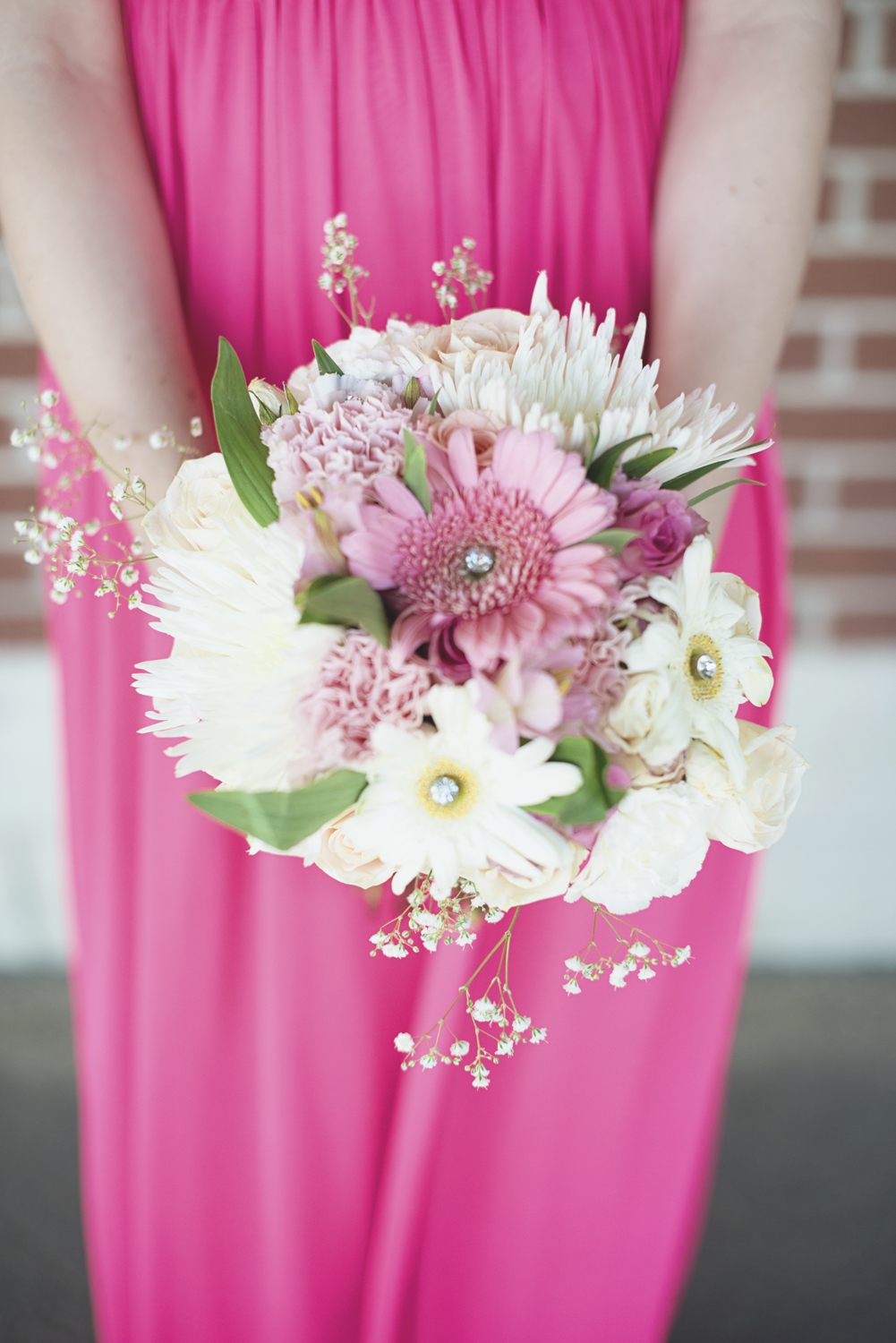 Pink, white, and silver wedding bouquet | Pink bridesmaid dress