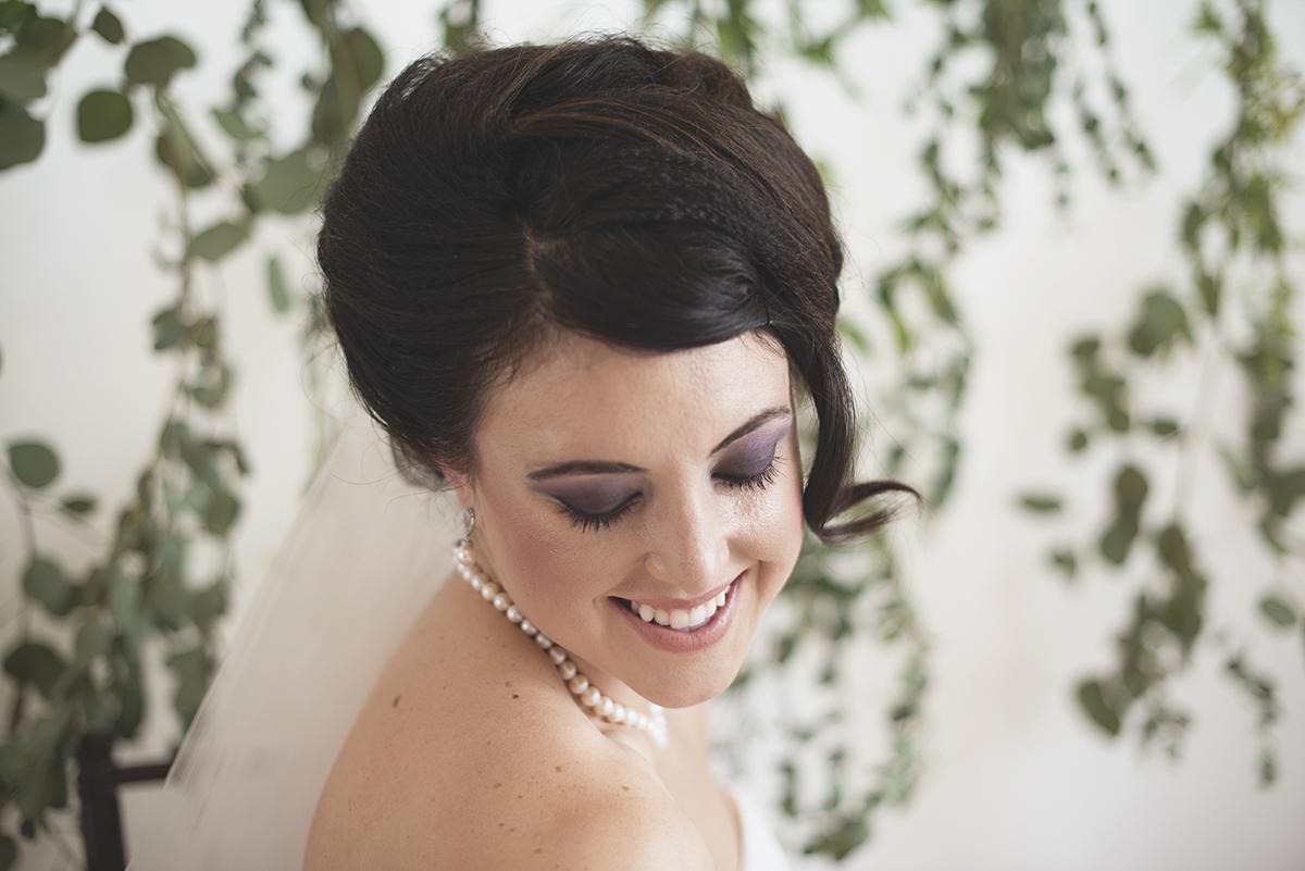 Bridal portrait with green vinebackground