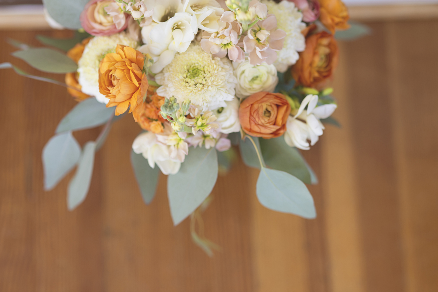 Inn at Warner Hall Wedding Pictures | Blush, tangerine, and white bridal bouquet with eucalyptus