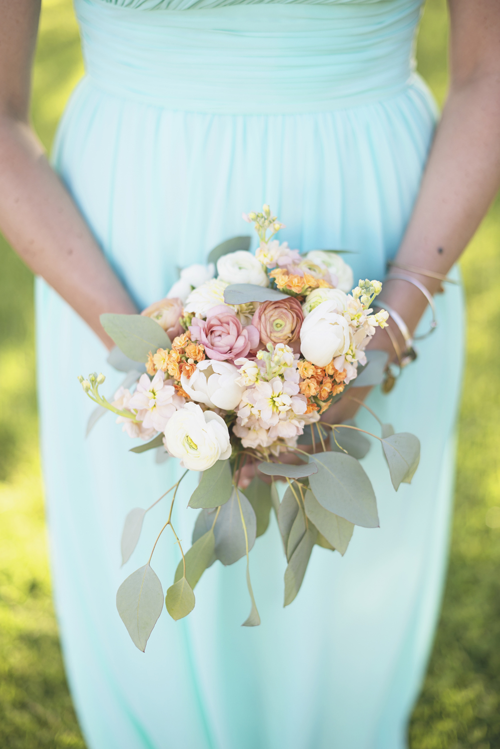 Inn at Warner Hall Wedding P  hotography | Blush, tangerine, and white bridal bouquet with eucalyptus leaves