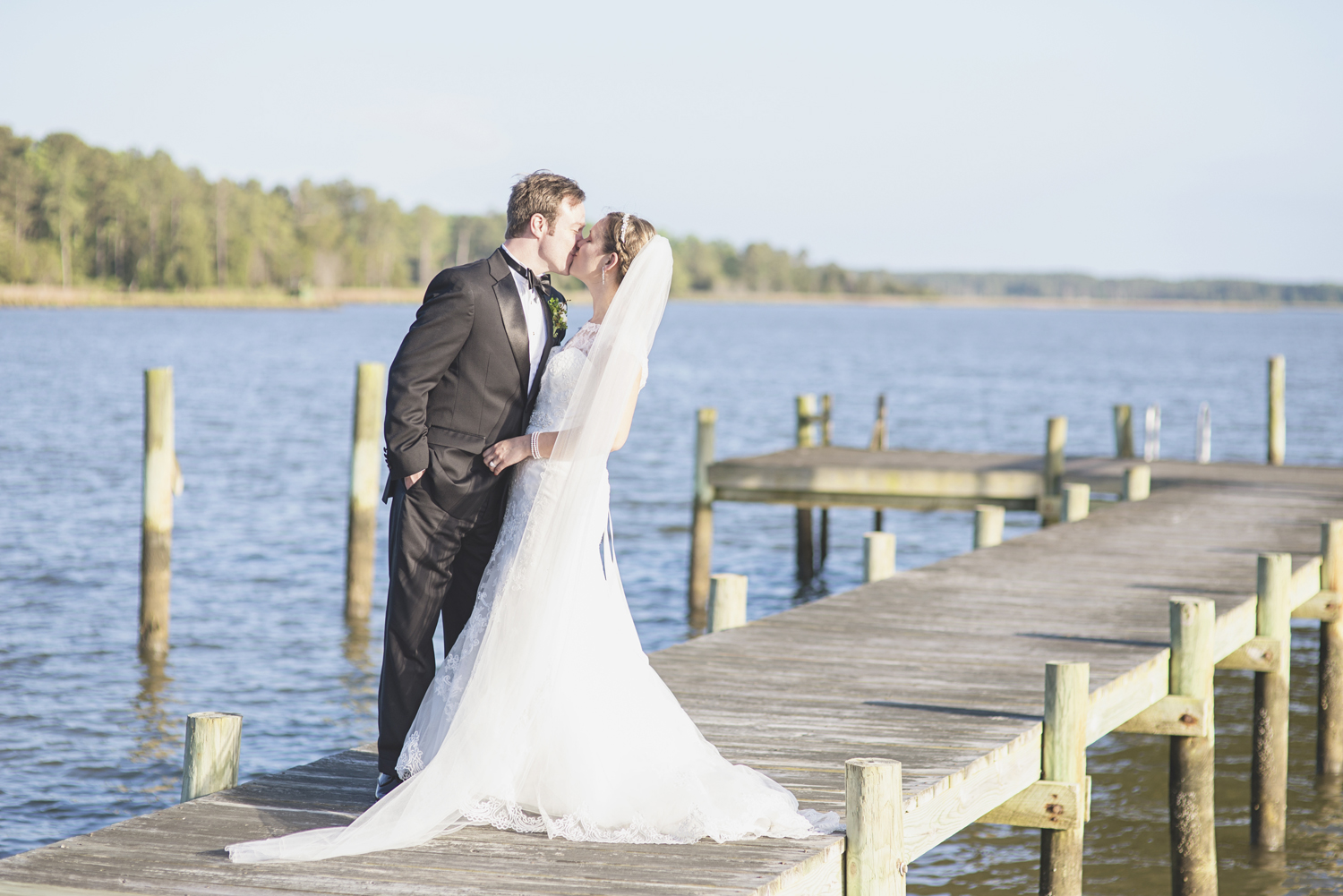 Inn at Warner Hall Wedding P  hotography | Bride & groom on dock by the water