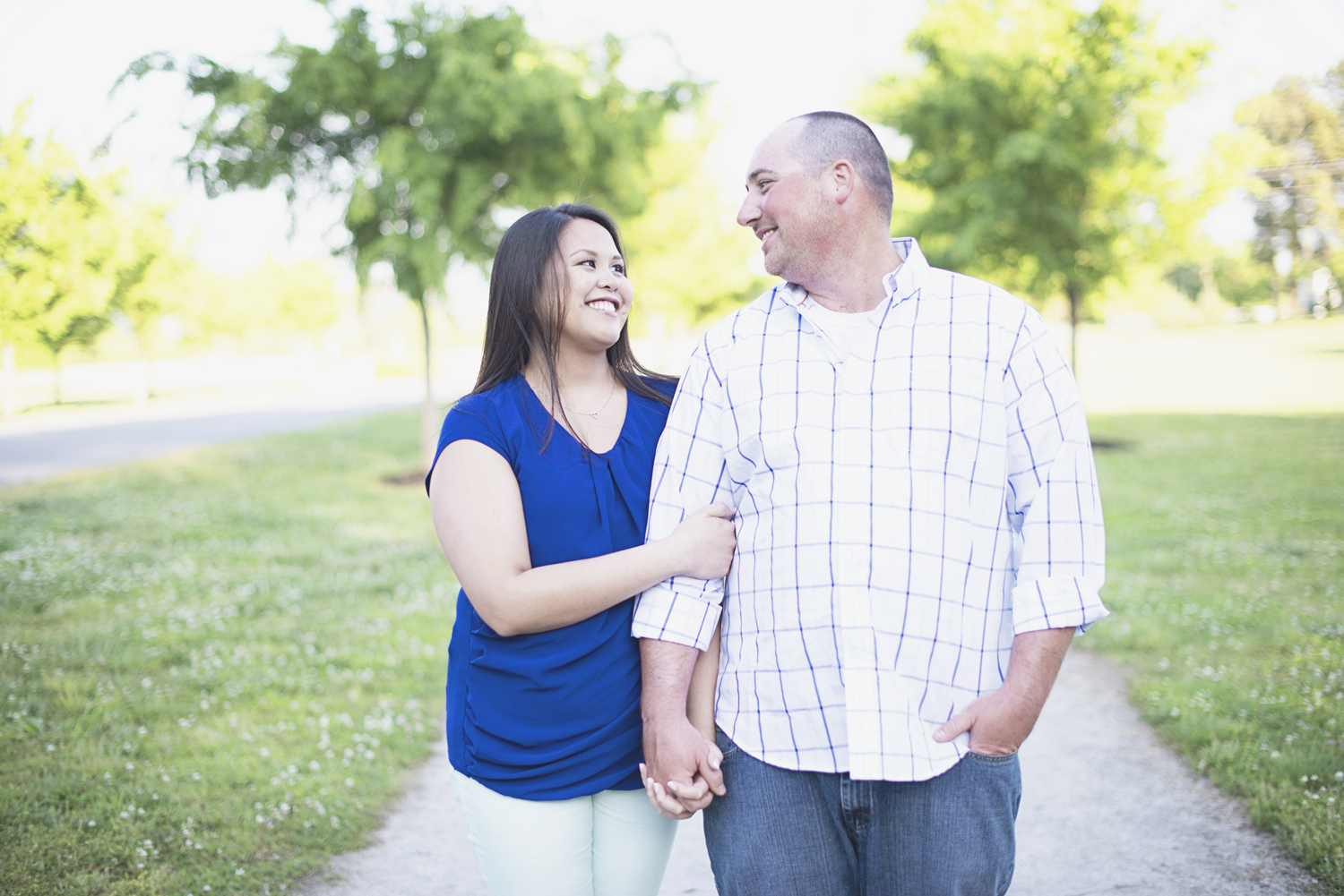Windsor Castle Park Engagement Session in Smithfield, Virginia | Teal and blue outfits