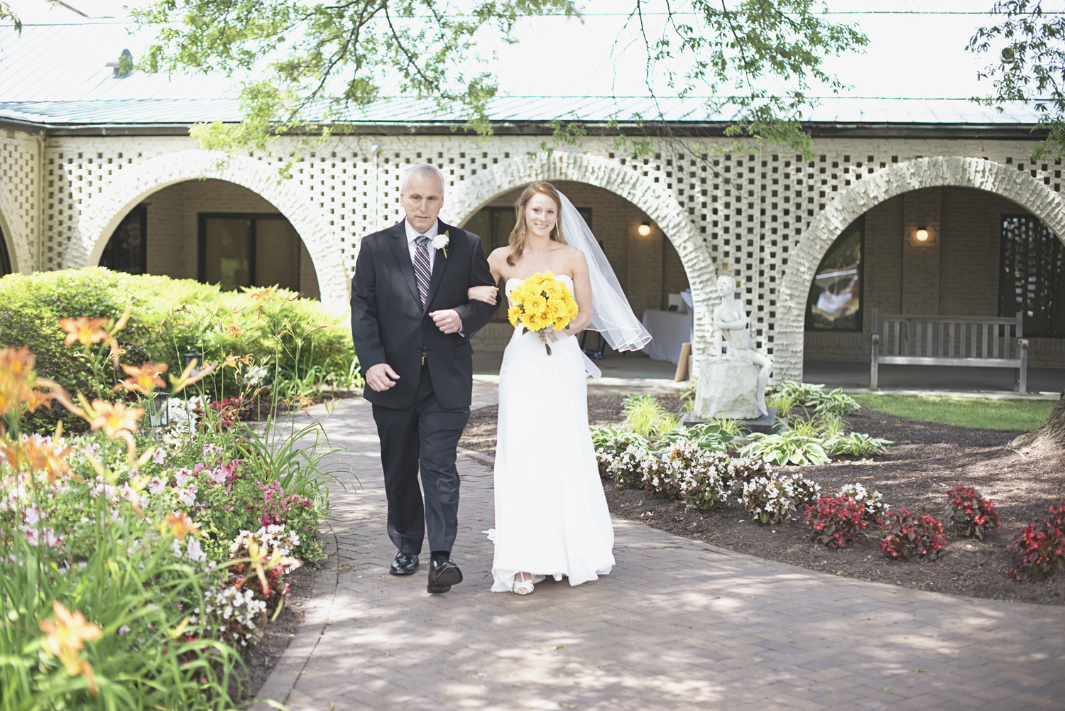Mariners Museum Wedding | Newport News, Virginia |  Bride in aisle with her father