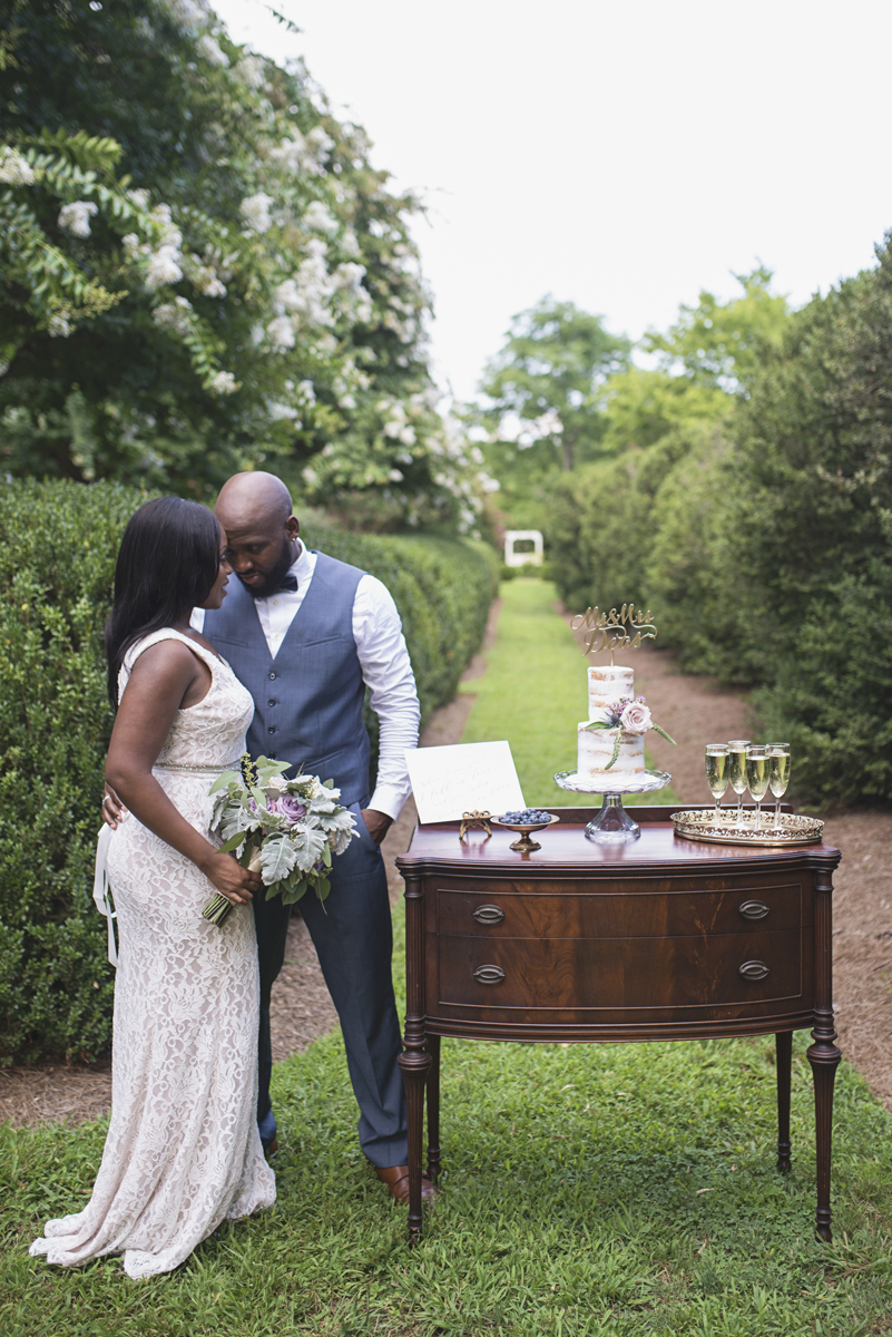 Elegant Lavender Plantation Elopement | Bride and groom portraits with styled cake table