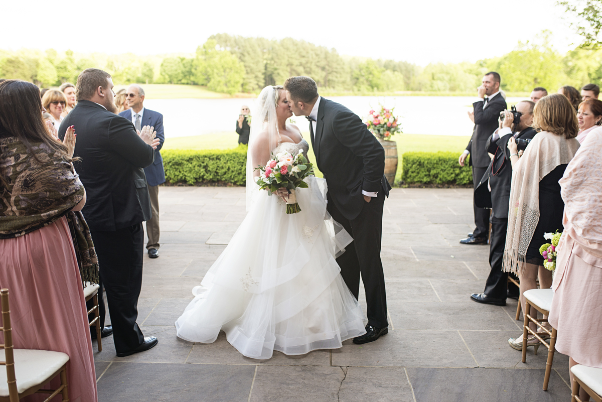 Albemarle Estate at Trump Winery Wedding   Bride and Groom Wedding Ceremony Kiss