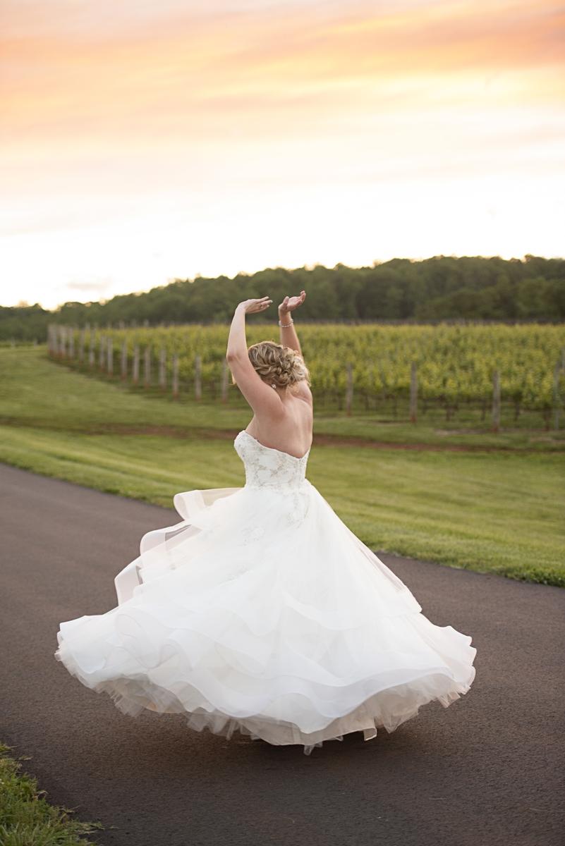 Albemarle Estate at Trump Winery Wedding   Bride Twirling at Sunset