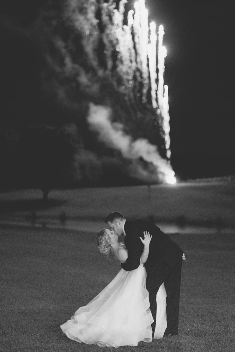 BrAlbemarle Estate at Trump Winery Wedding   Bride and Groom Fireworks Kiss