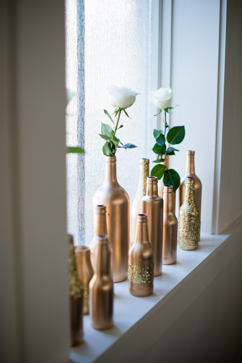 Sparkly Gold and White Fall Wedding | Gold Bottle and White Rose Ceremony Decorations