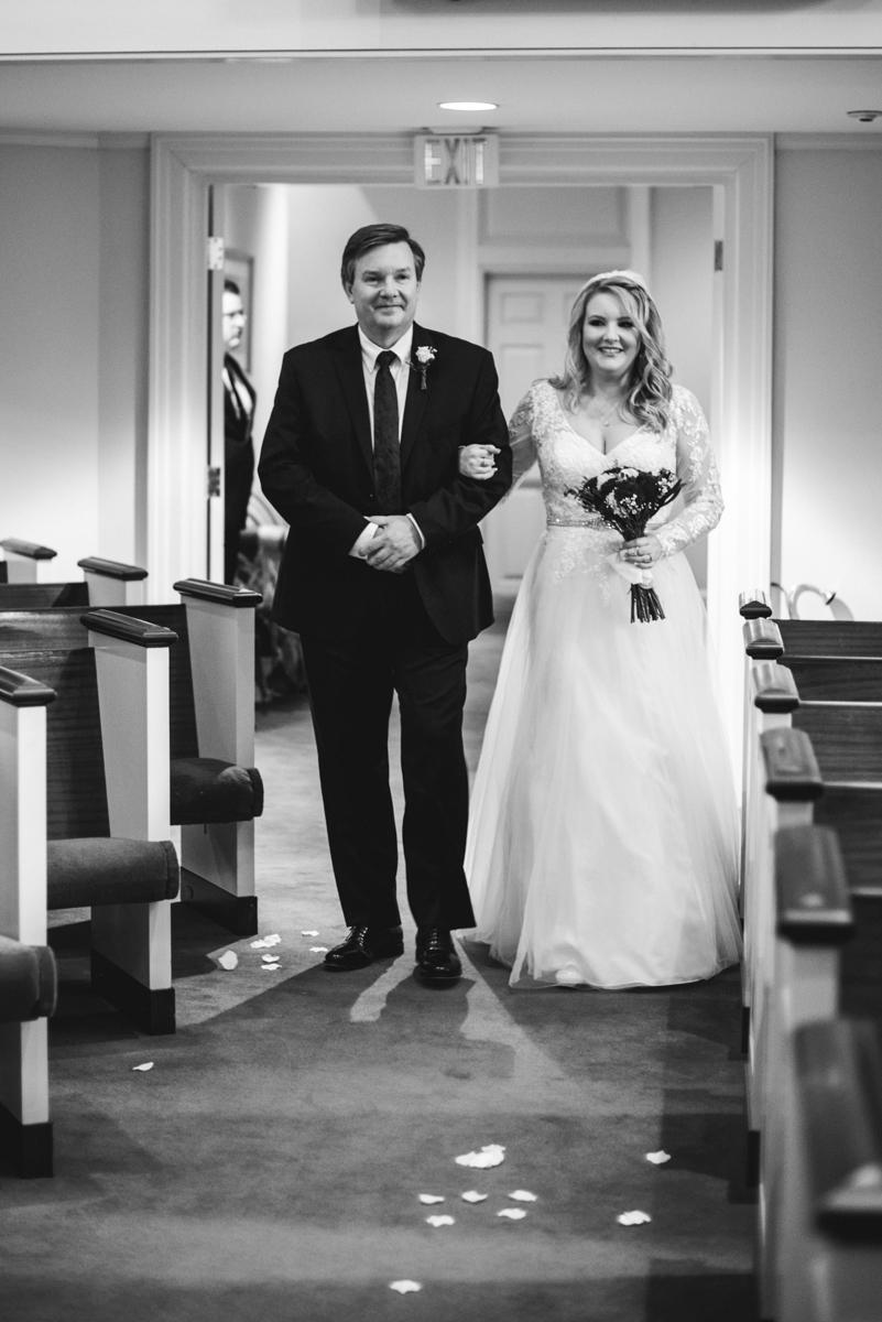 Burgundy and Blush Winter Wedding | Bride walking down the aisle