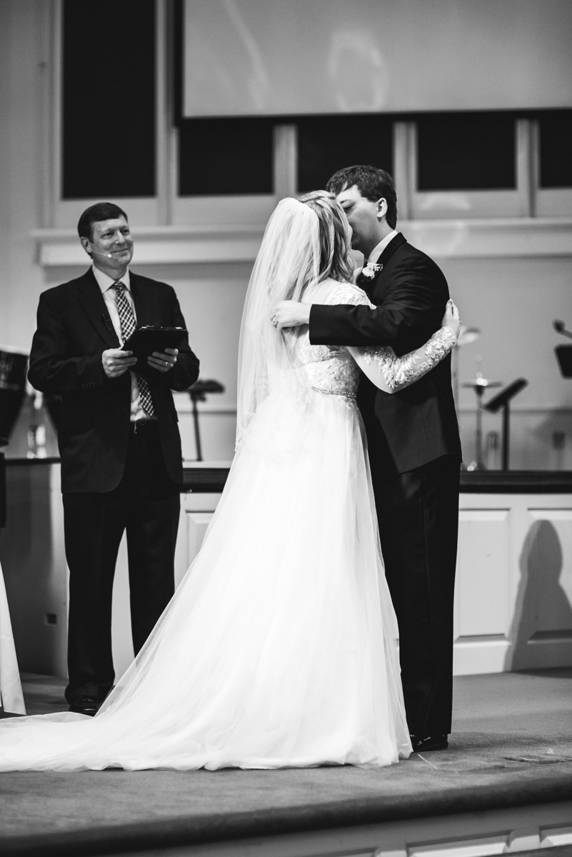 Burgundy and Blush Winter Wedding | Bride and Groom first kiss