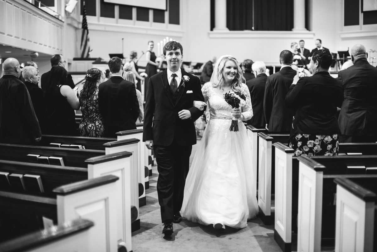 Burgundy and Blush Winter Wedding | Bride and groom recessional