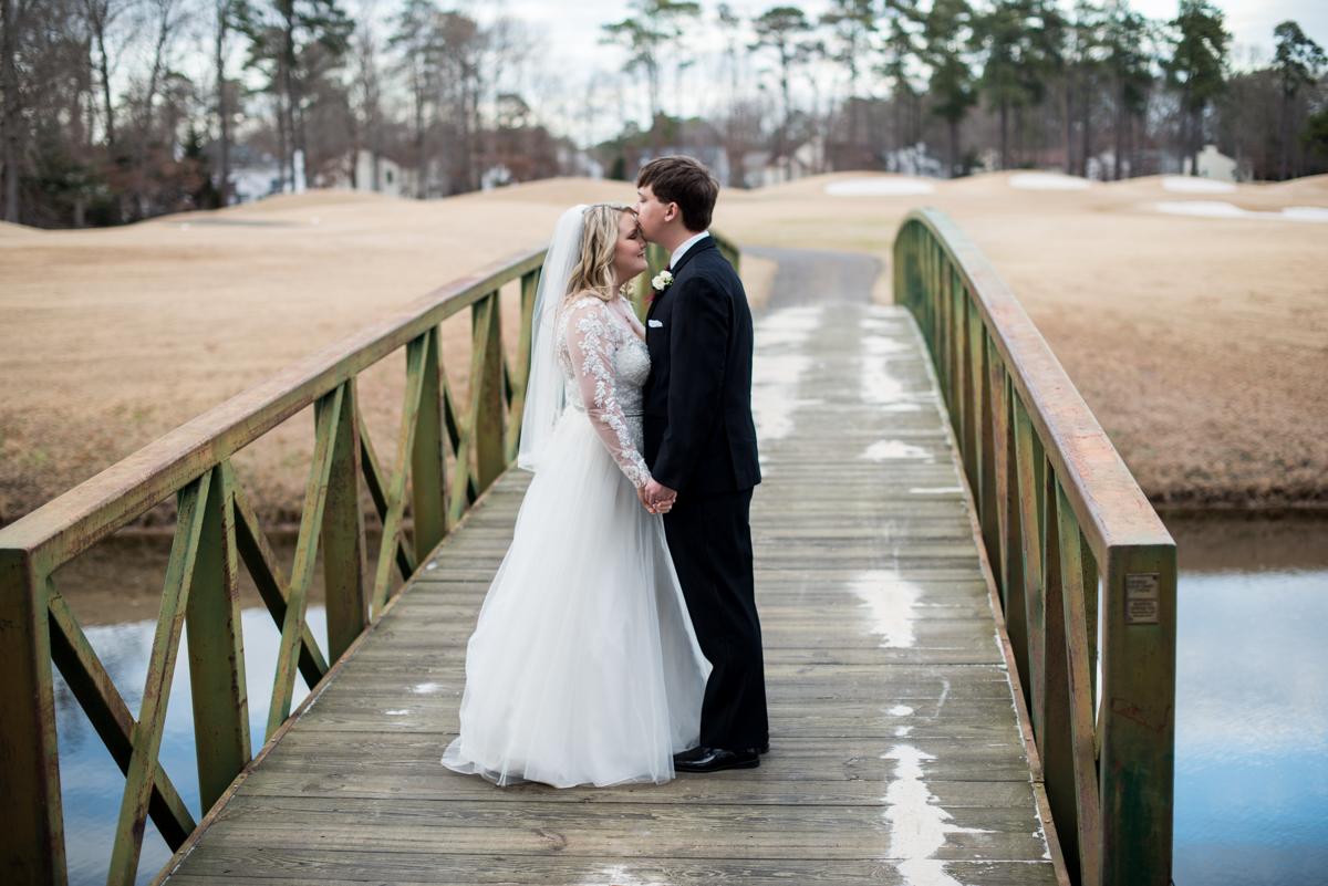 Burgundy and Blush Winter Wedding | Bride and groom bridge portraits