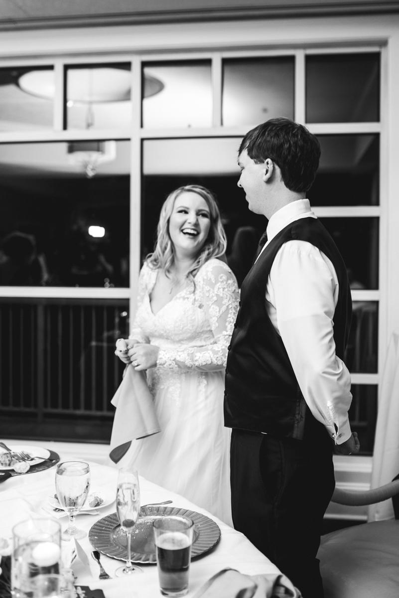 Burgundy and Blush Winter Wedding | Bride and groom at wedding reception