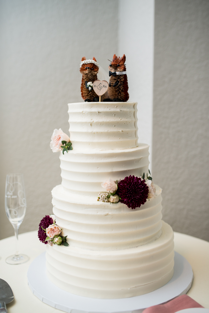 Burgundy and Blush Winter Wedding | White wedding cake with fox cake toppers