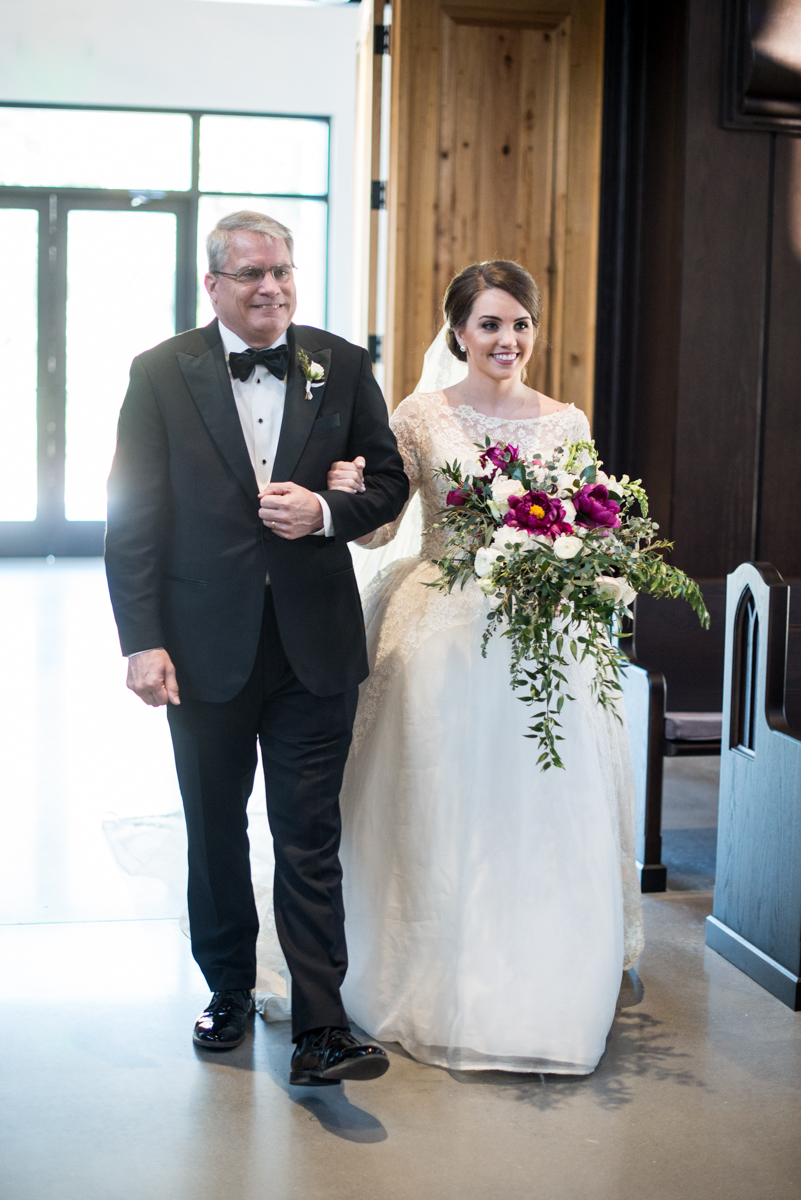 Navy, Wine, and Gold Charleston Wedding | Bride walking down aisle with dad