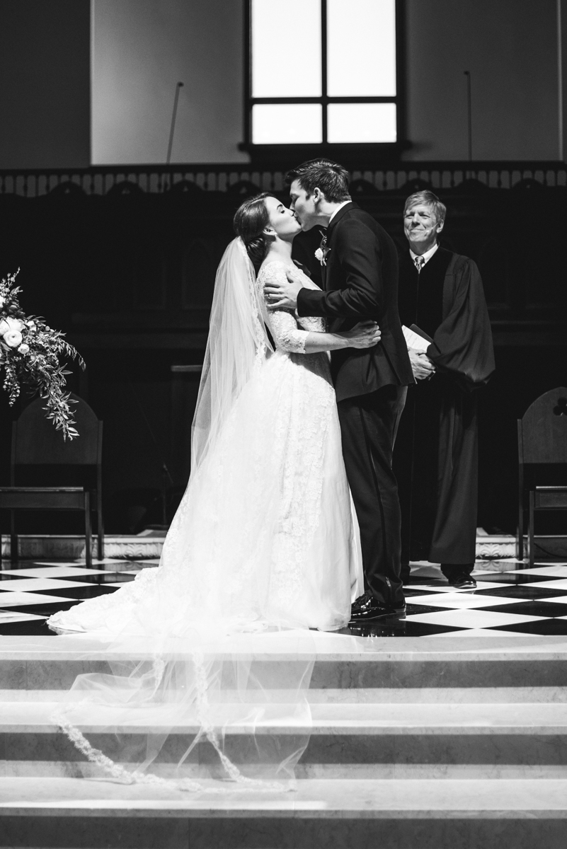 Navy, Wine, and Gold Charleston Wedding | Bride and groom first kiss